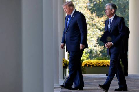 FILE - In this Nov. 2, 2017, file photo President Donald Trump walks with Federal Reserve board ...