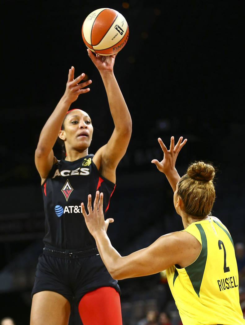 Las Vegas Aces center A'ja Wilson (22) shoots over Seattle Storm center Mercedes Russell (2) du ...