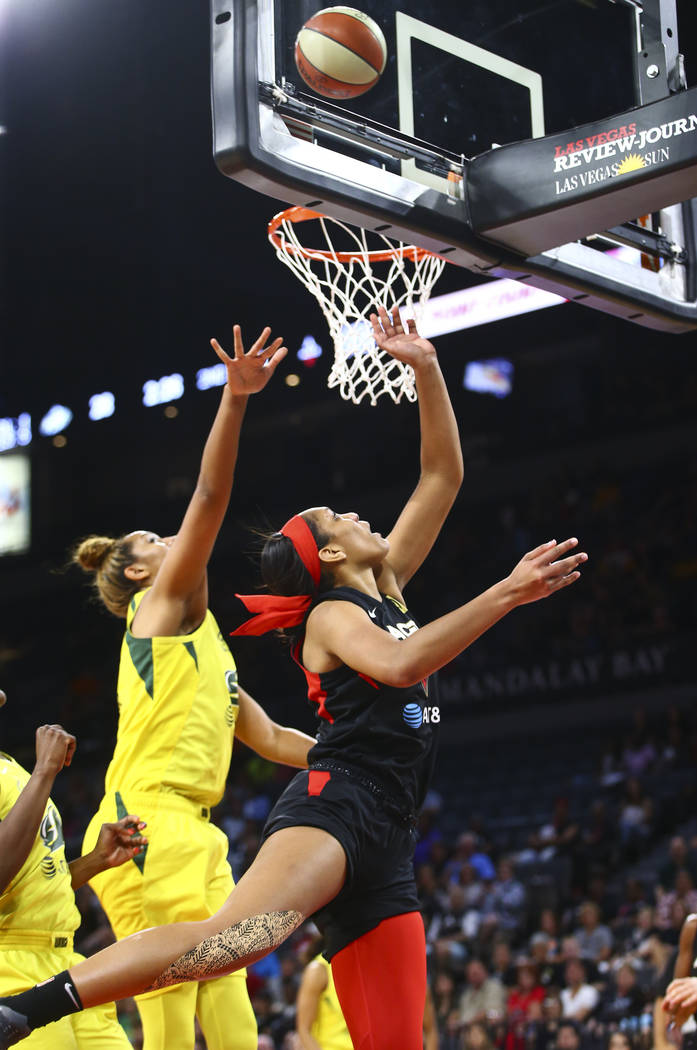 Las Vegas Aces center A'ja Wilson goes to the basket past Seattle Storm center Mercedes Russell ...