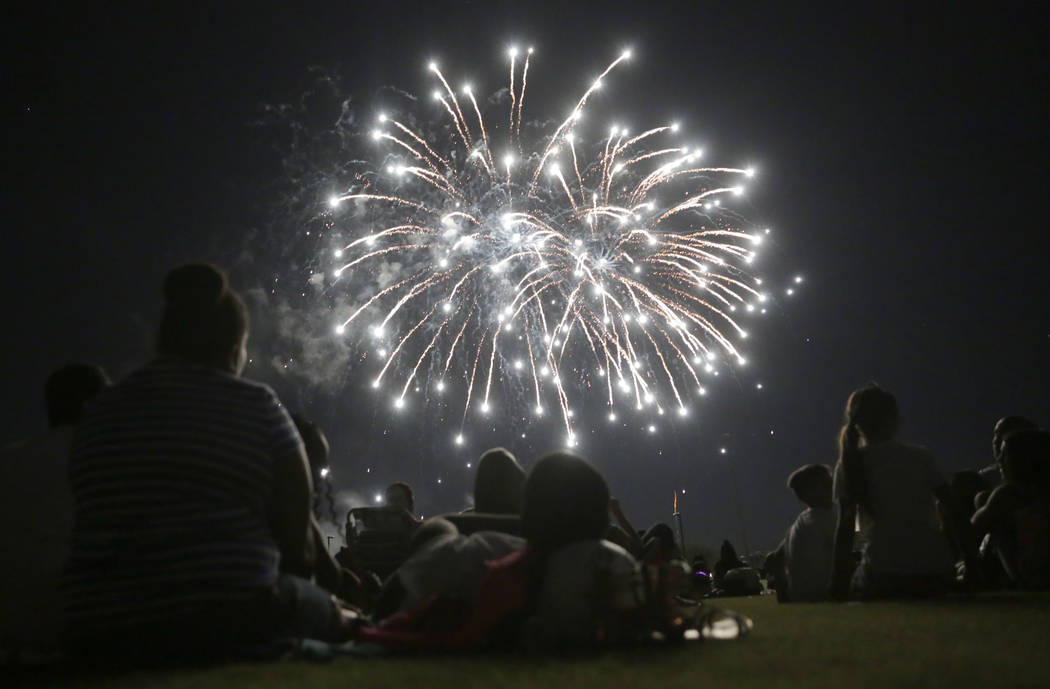 People enjoy the fireworks show at the City of Henderson's Fourth of July celebration at Herita ...