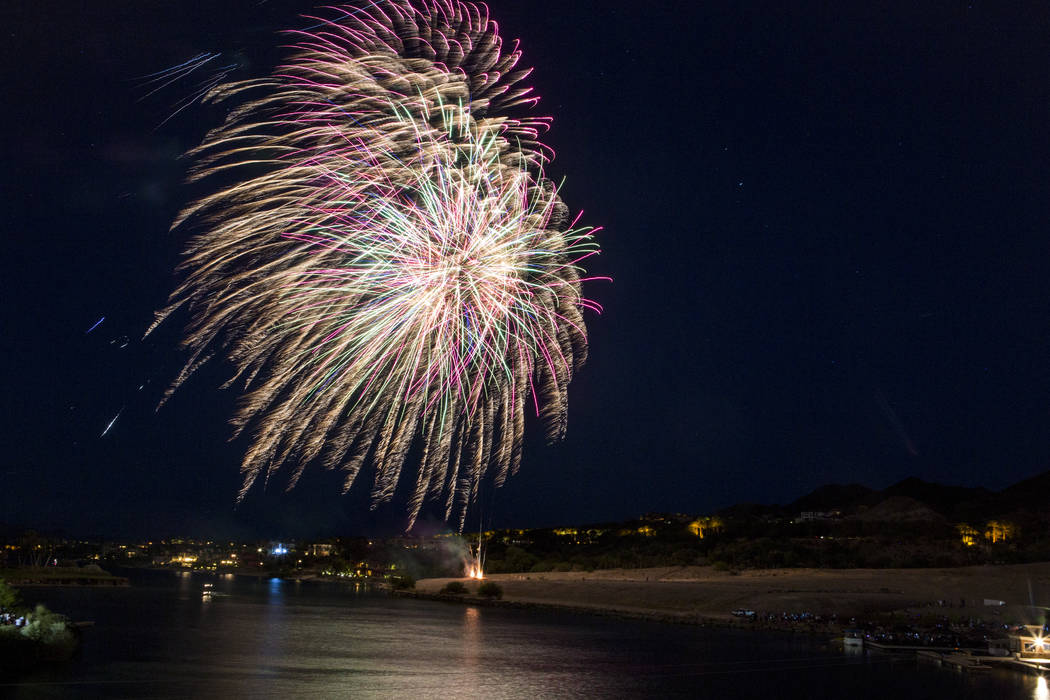 A fireworks display during Fourth of July weekend celebrations at Lake Las Vegas on Sunday, Jul ...