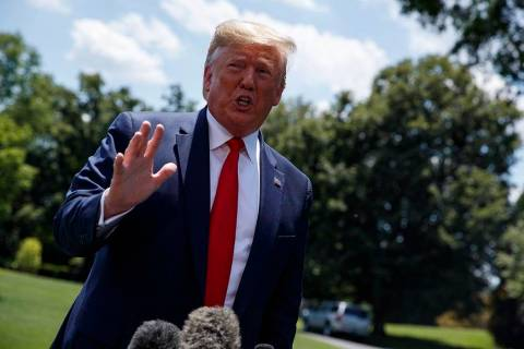 President Donald Trump talks with reporters before departing to Japan for the G20 summit, Wedne ...