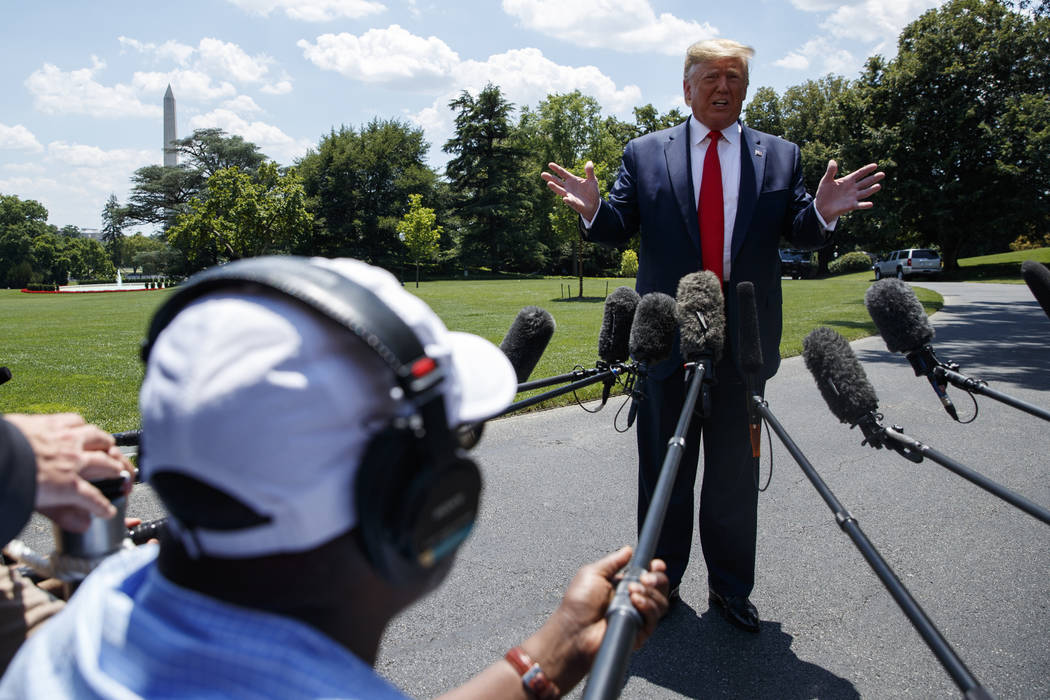 President Donald Trump talks with reporters before departing to Japan for the G20 summit on the ...