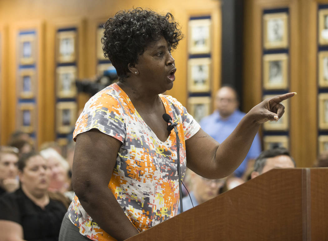 Suynn Davis, who's grandson attends Arbor View High School, addresses the Clark County School D ...