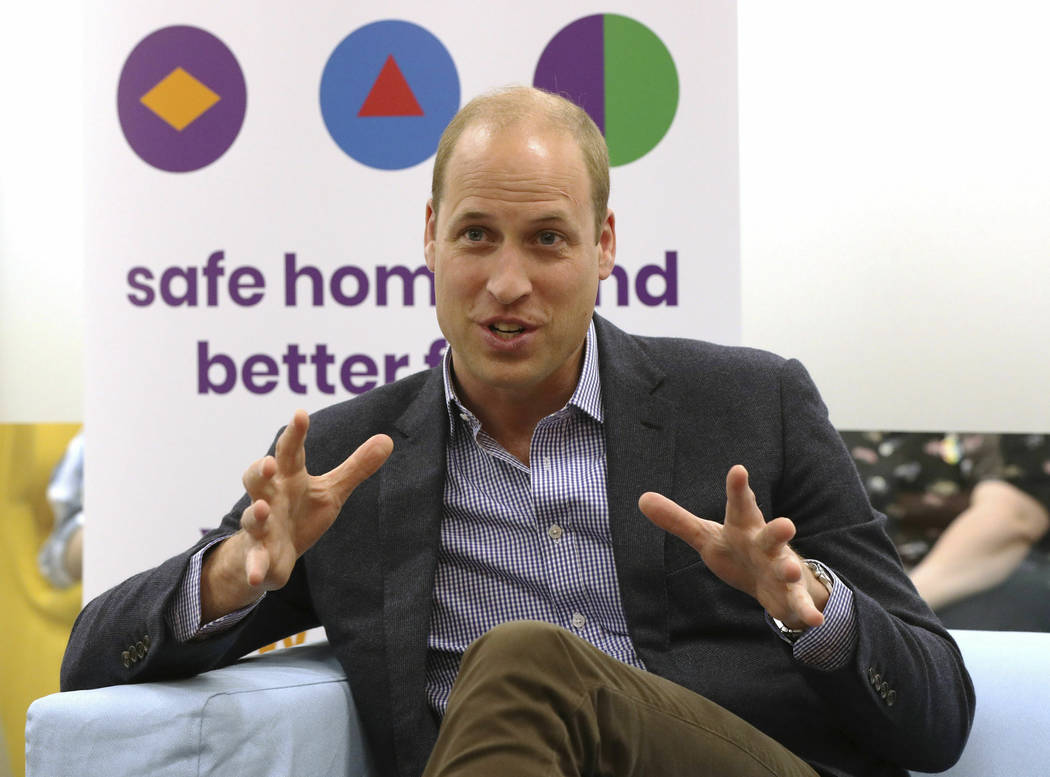 Britain's Prince William, the Duke of Cambridge, speaks to former and current service users dur ...