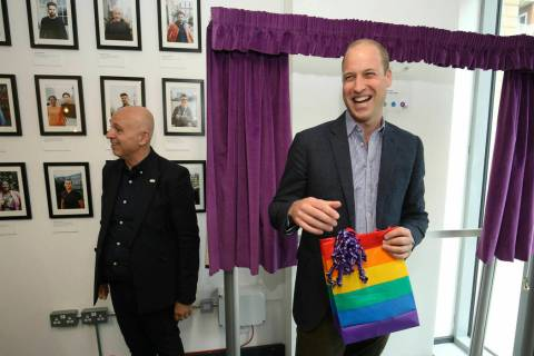 Britain's Prince William, the Duke of Cambridge, reacts to receiving a gift bag from trust chie ...