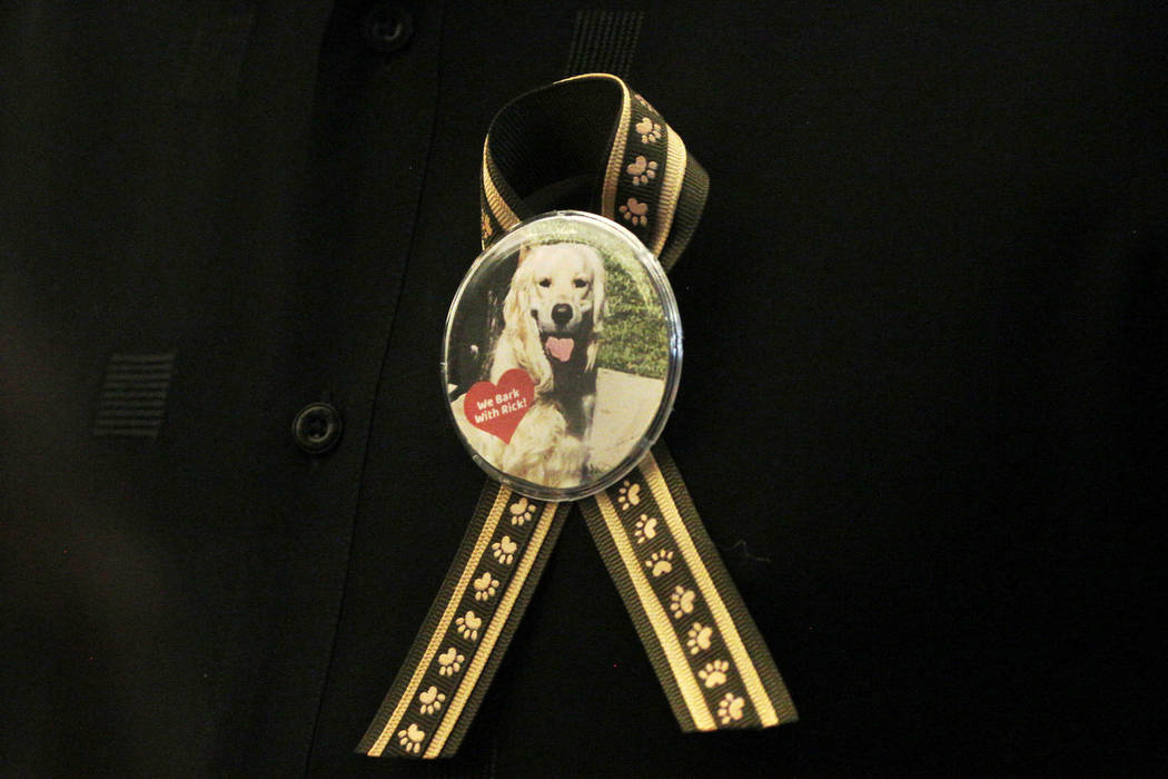 A supporter of dog trainer Ricky Allen Davis wears a button during Davis' hearing at Regional J ...