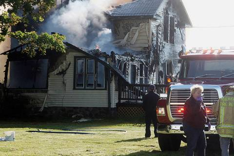 Responders work the scene of a deadly house fire in Pickerel, Wis., Tuesday, June 25, 2019. Aut ...