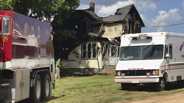 This image made from video provided by WSAW-TV shows a damaged house after a fire in Pickerel, ...