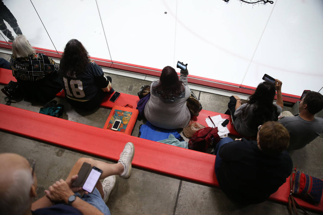 Fans watch the Vegas Golden Knights during a team practice at City National Arena in Las Vegas, ...