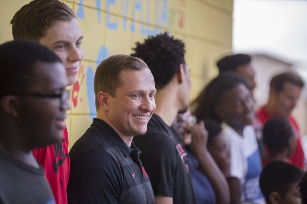 UNLV head basketball coach T.J. Otzelberger, third from left, jokes around with kids during a y ...