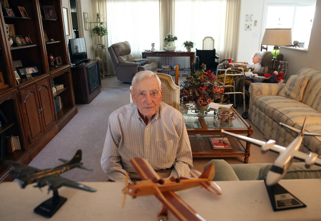 U. S. Army Air Corps and the U.S. Air Force pilot James Parker, 97, poses for a photo at his La ...