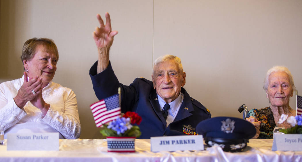 "James ""Jim"" A. Parker waves in recognition beside daughter Susan, left, and wife, Joy ..."