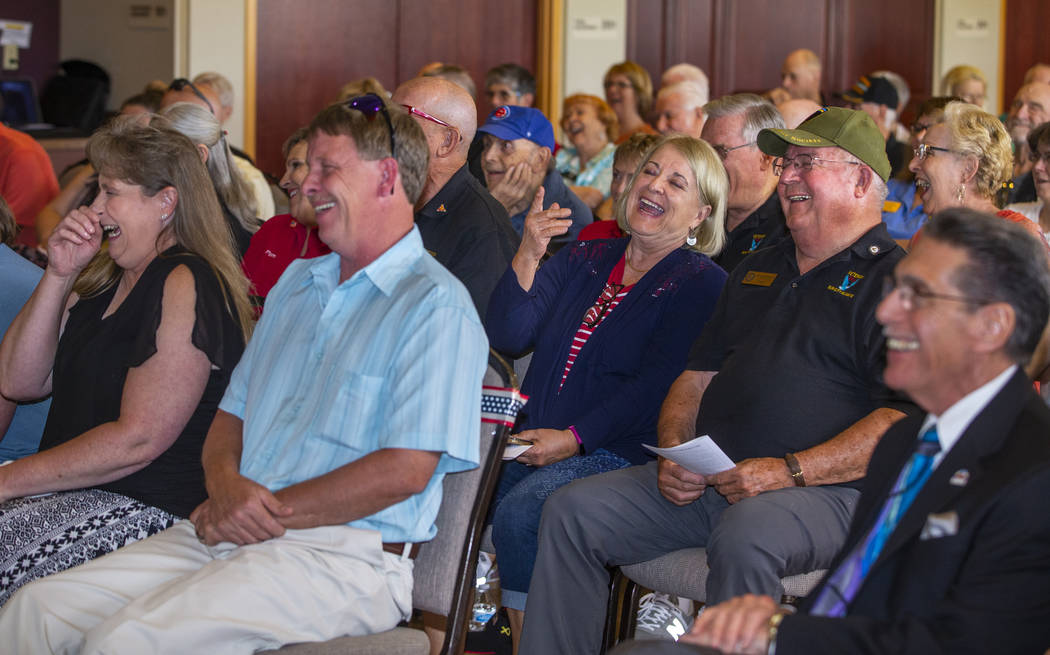Invited guests enjoy a video as The Veterans Club of Sun City Aliante and the city of North Las ...
