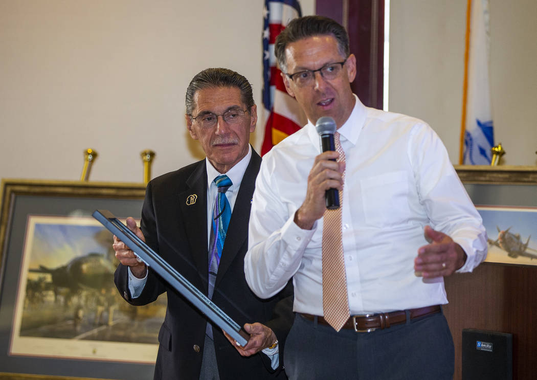 North Las Vegas city councilmen Richard Cherico, left, and Scott Black present a proclamation a ...