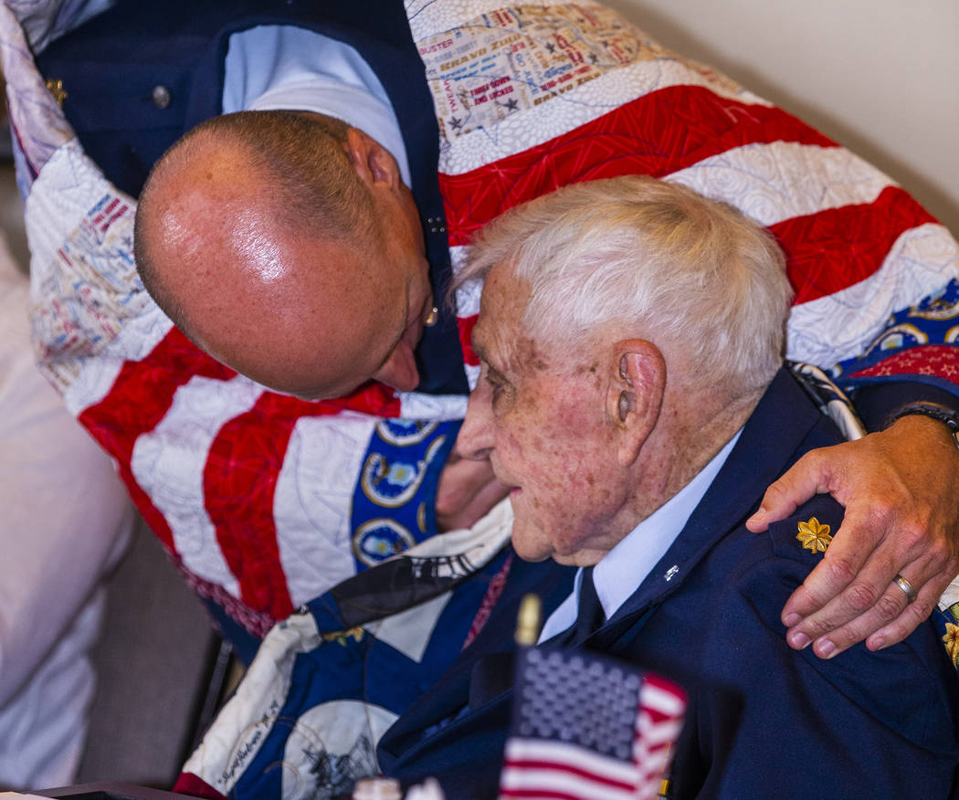 "Retired Air Force Maj. Trent Arnold hugs his grandfather James ""Jim"" A. Parker as Th ..."