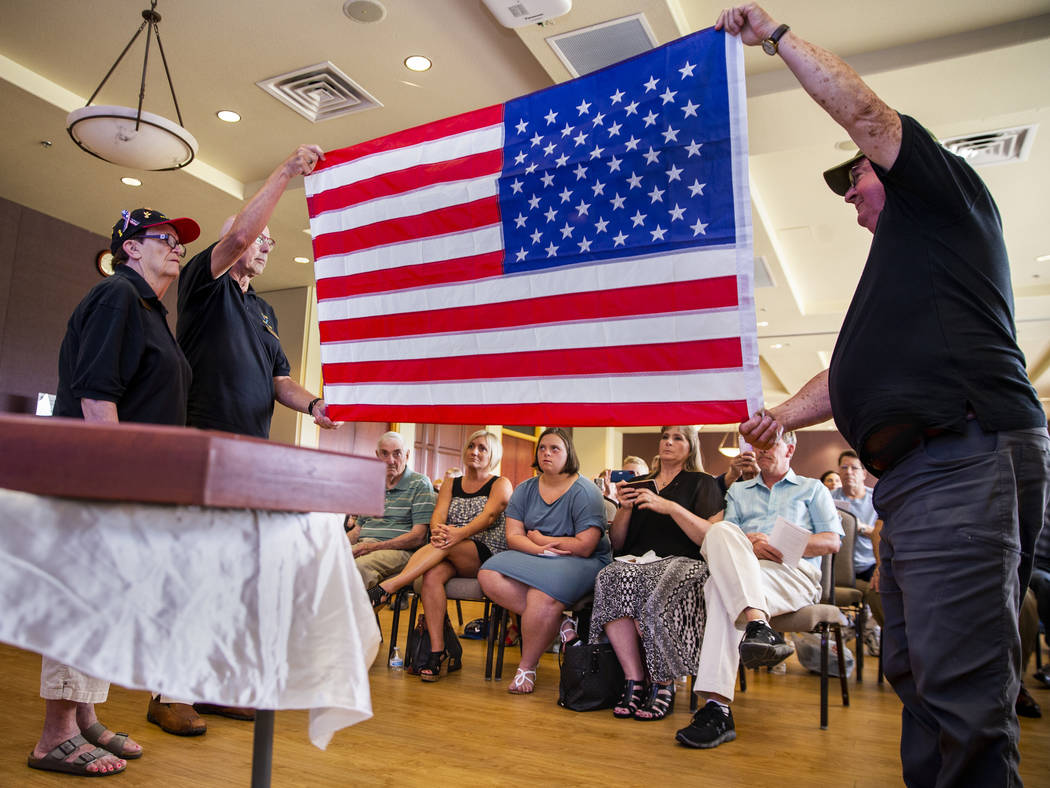 "Liz Meyer, Karl Vonderohe and Ken Knudson fold an American flag presented to James ""Jim&qu ..."