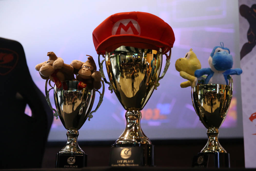 Winner trophies on display during the Super Smash Bros. Ultimate Showdown tournament at GameWor ...