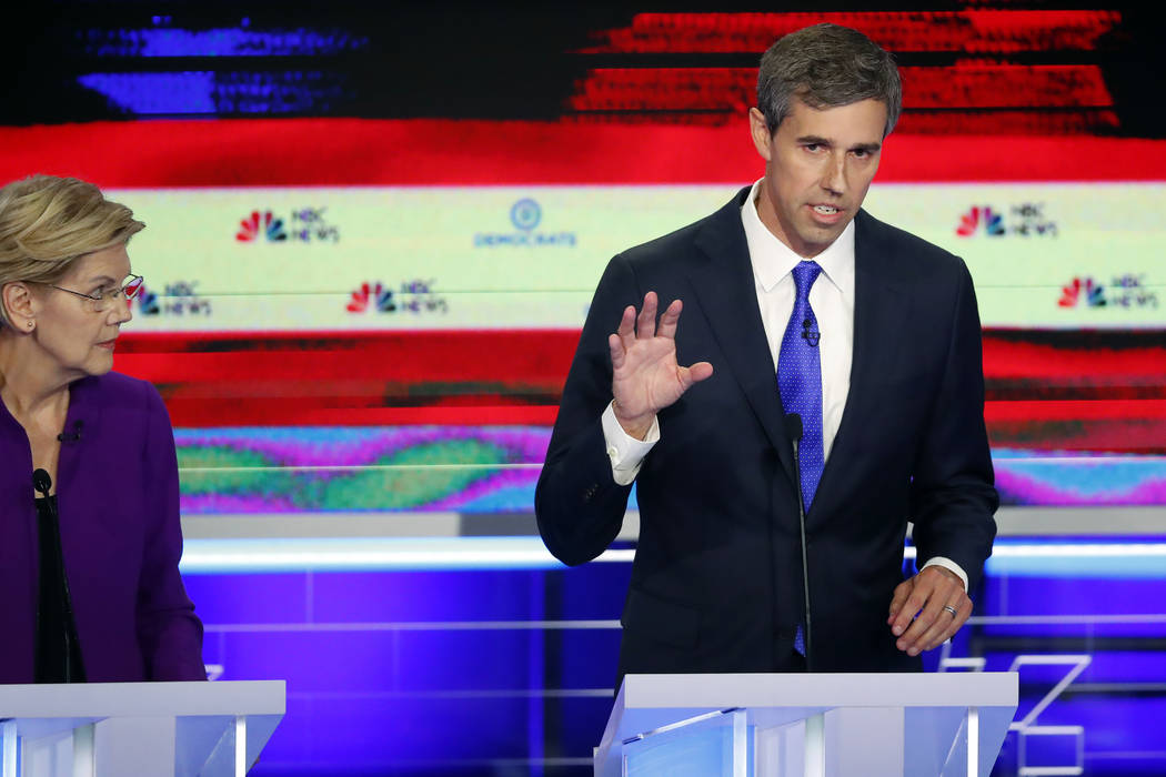 Democratic presidential candidate former Texas Rep. Beto O'Rourke answers a questions as Sen. E ...