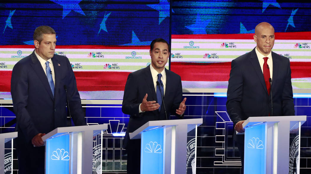 Democratic presidential candidate former Housing Secretary Julian Castro, center, speaks at the ...
