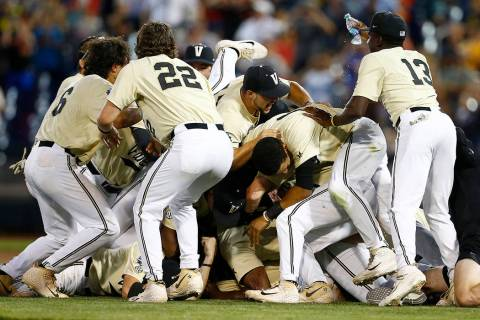 Vanderbilt players celebrate after defeating Michigan in Game 3 of the NCAA College World Serie ...