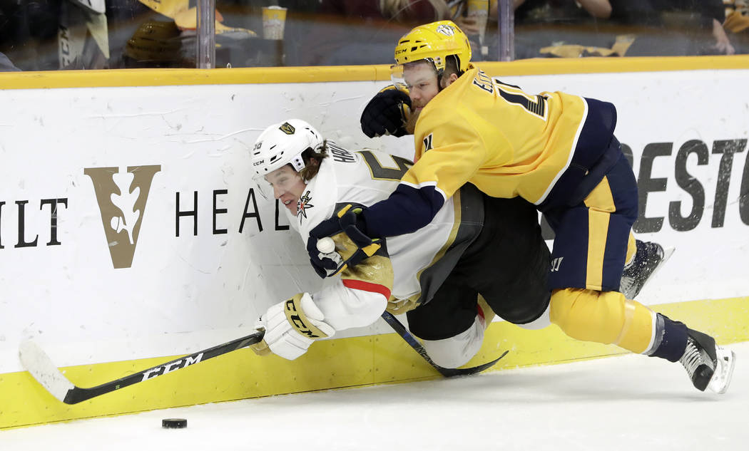 Nashville Predators defenseman Ryan Ellis (4) brings down Vegas Golden Knights center Erik Haul ...