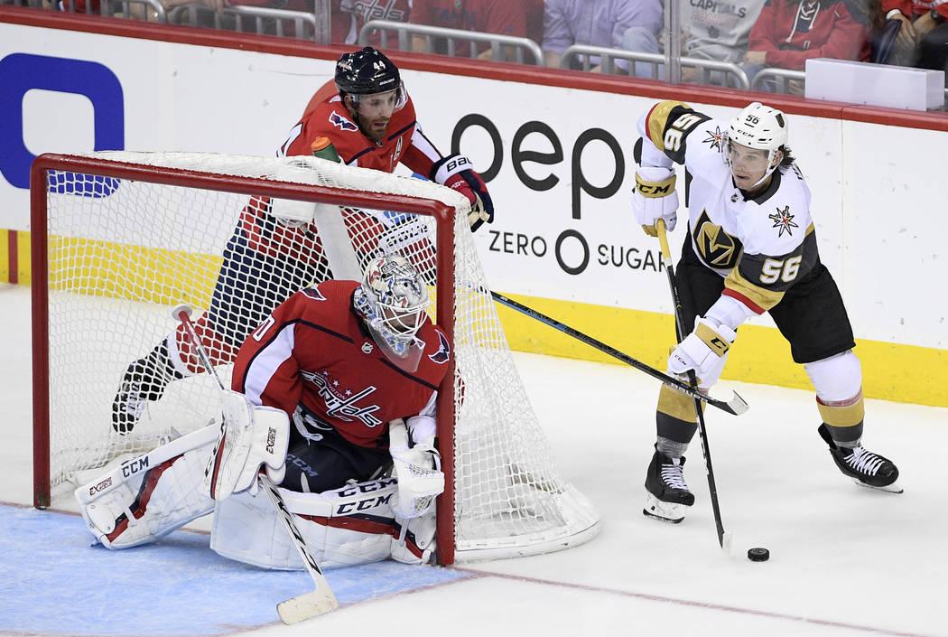 Vegas Golden Knights left wing Erik Haula (56) skates with the puck next to Washington Capitals ...