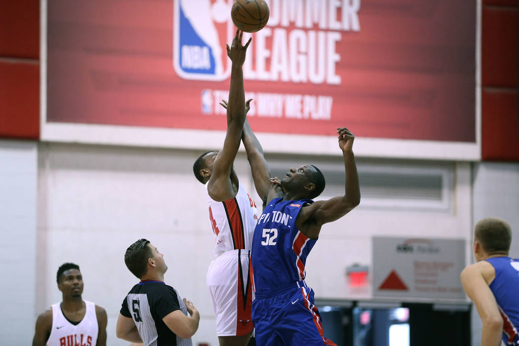 Chicago Bulls' Wendell Carter Jr. (34), and Detroit Pistons' Nnanna Egwu (52) jump for the ball ...
