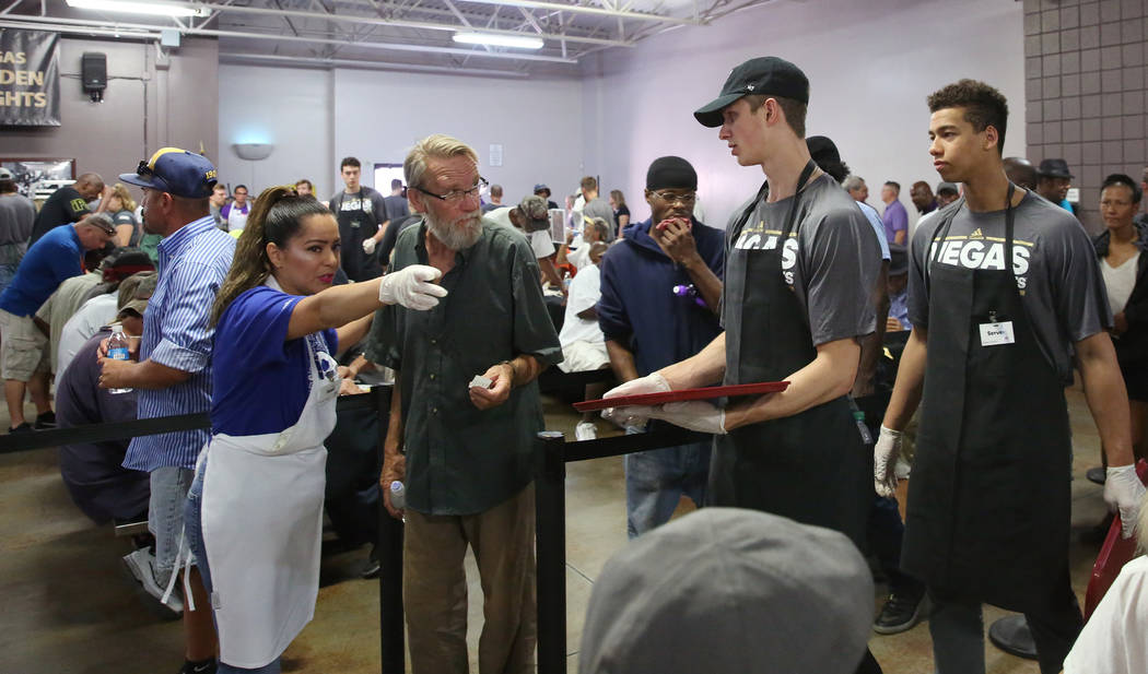 Karla Hernandez, a volunteer, assigns clients to Vegas Golden Knights Development Camp particip ...