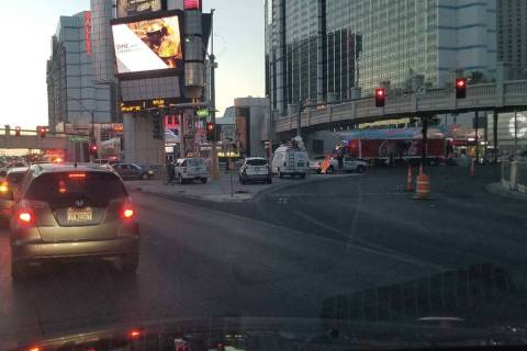 Las Vegas police investigate a four-vehicle crash on the Las Vegas Strip at Flamingo Road on Th ...