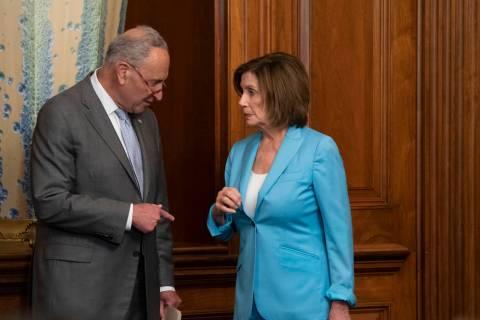 Senate Minority Leader Chuck Schumer, D-N.Y., left, talks with Speaker of the House Nancy Pelos ...