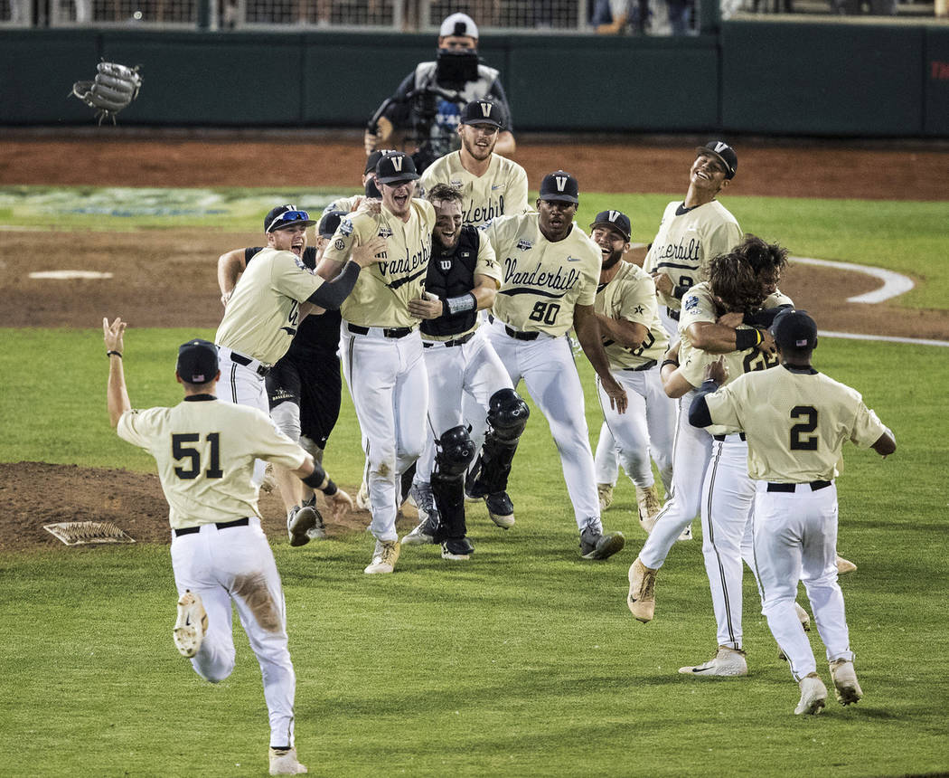 Vanderbilt celebrates an 8-2 win over Michigan during the deciding game of the NCAA College Wor ...