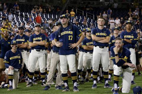 Michigan players including Jeff Criswell (17) watch as Vanderbilt celebrates after Vanderbilt d ...