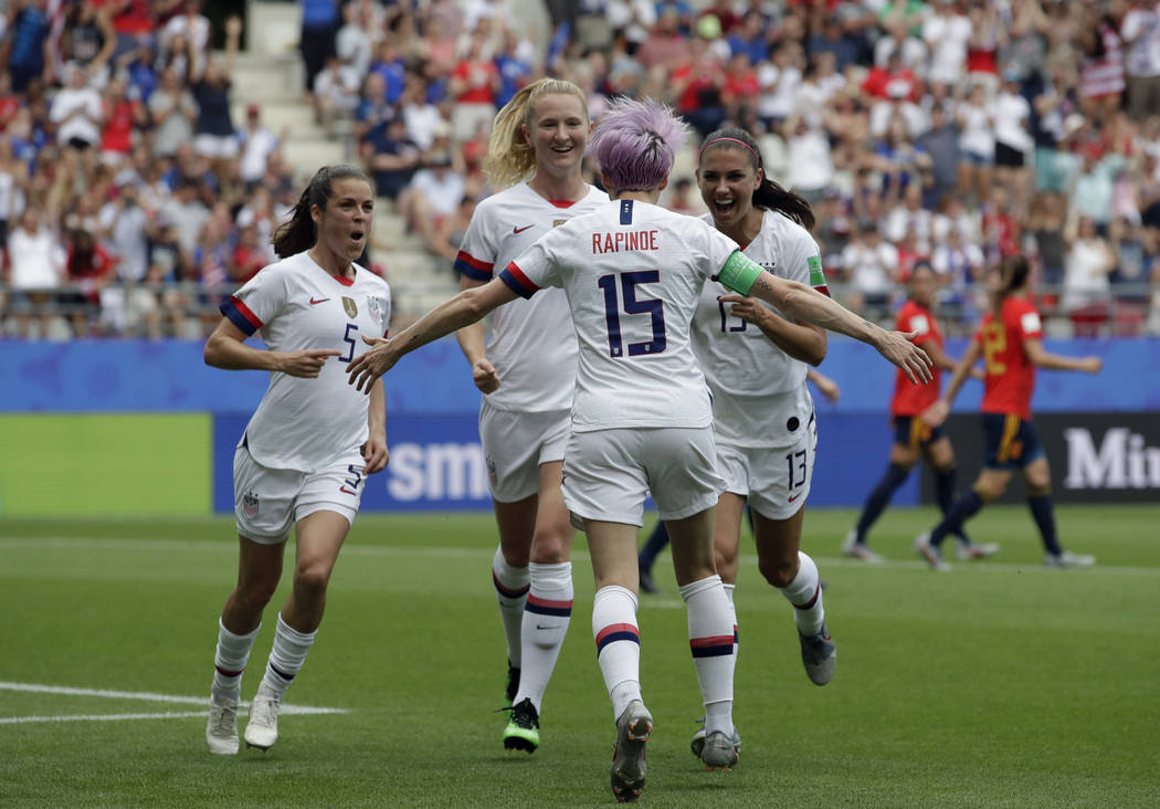 United States' Megan Rapinoe, front, celebrates with teammates after scoring the opening goal f ...