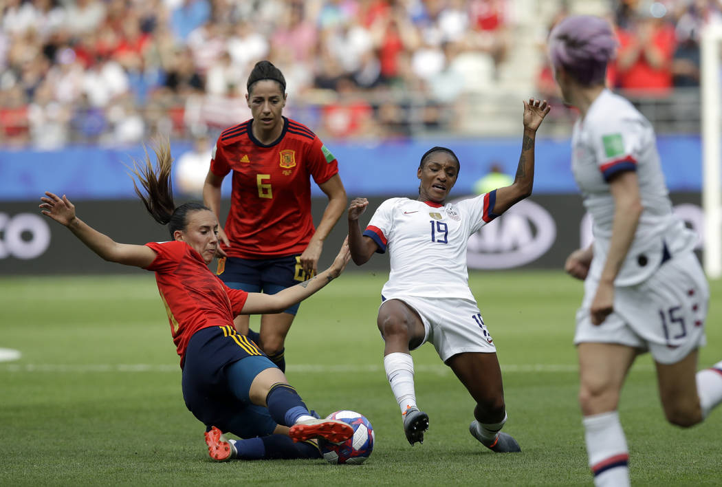 Spain's Virginia Torrecilla, left, defends against United States'Crystal Dunn, right, during th ...