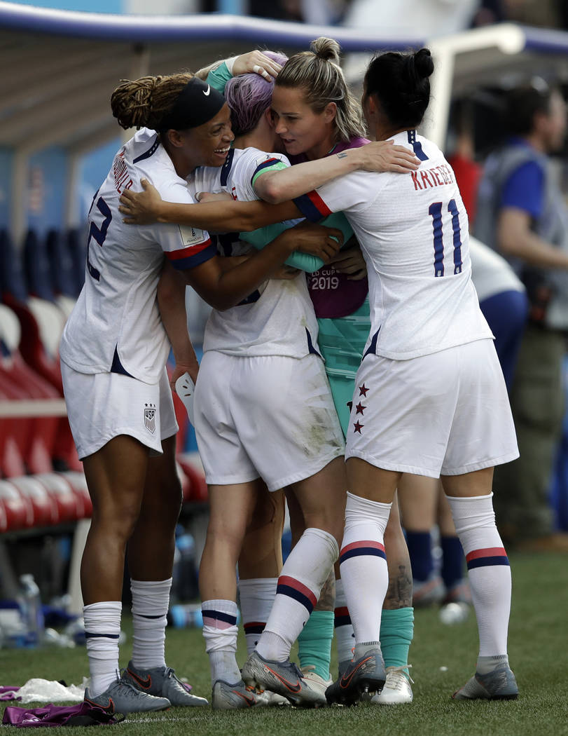 United States players celebrates at the end of the Women's World Cup round of 16 soccer match b ...