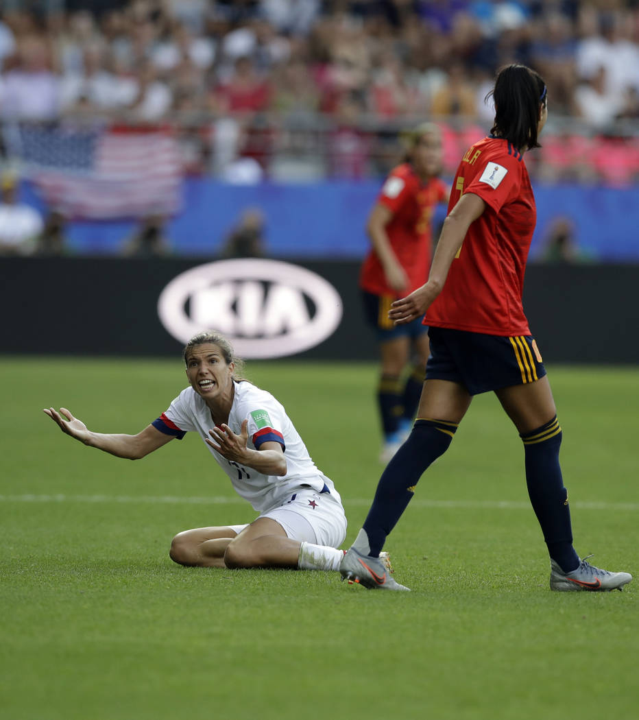 United States'Tobin Heath, left, reacts after a foul by Spain's Leila Ouahabi during the Women' ...