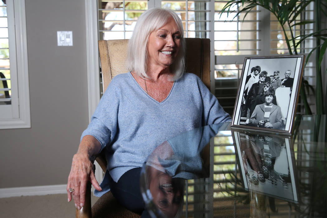 Sonnie Sims, a retired flight attendant, with a picture of herself with the Beatles in 1966, at ...
