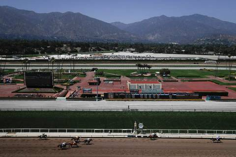 Horses finish the fourth race during the last day of the winter/spring meet at the Santa Anita ...