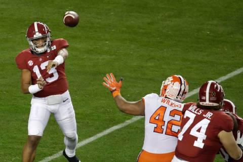 Alabama's Tua Tagovailoa throws during the first half the NCAA college football playoff champio ...