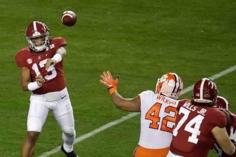 Alabama's Tua Tagovailoa throws during the first half the NCAA college football playoff champio ...