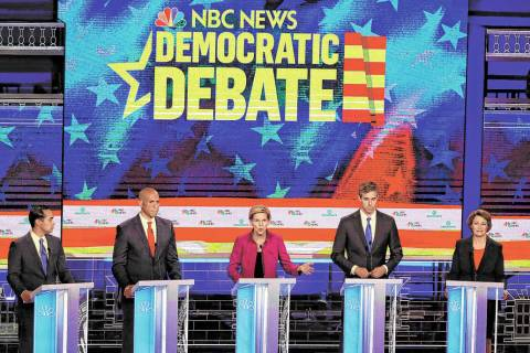 Democratic presidential candidate Sen. Elizabeth Warren, D-Mass., center, answers a question, d ...