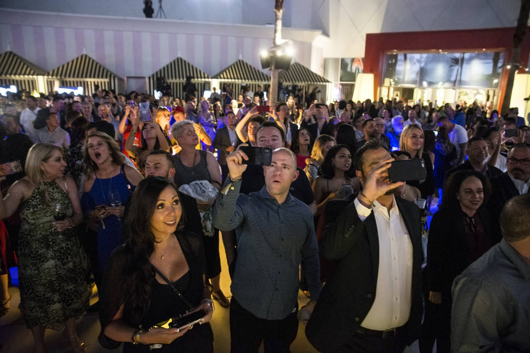 Attendees react to a fireworks show highlighting an event to announce the renaming of SLS Las V ...