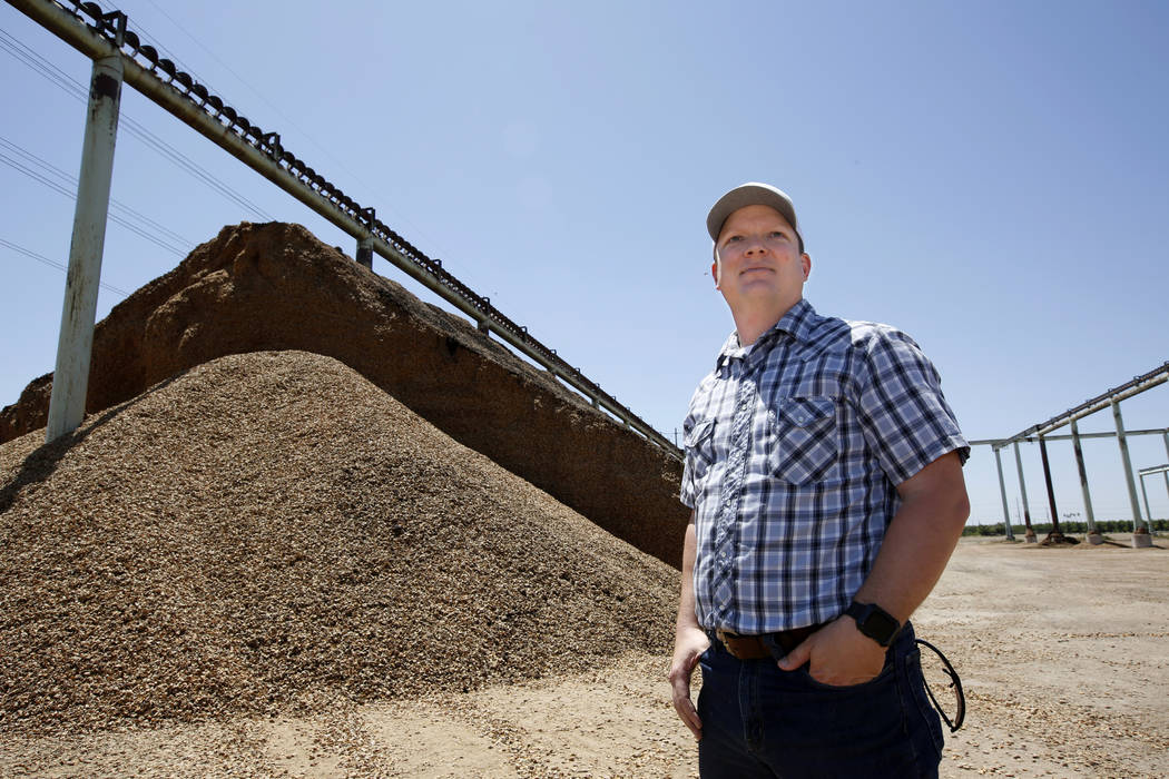 In this Friday June 21, 2019 photo, almond farmer Jake Wenger, assistant manager at Salida Hull ...