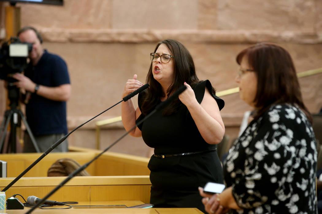 Parent and Leavitt Middle School teacher Alexis Salt speaks a Clark County School Board meeting ...