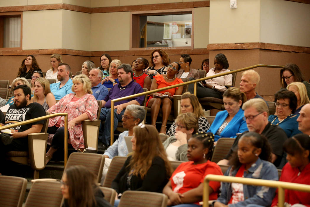 Audience members listen during a Clark County School Board meeting at the Clark County Governme ...