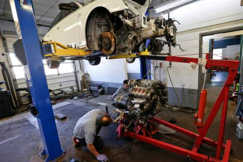 Automotive technicians Don Dimond, left, and Bernie Rabinovitz prepare to separate an engine an ...