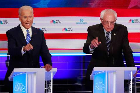 Democratic presidential candidate former vice president Joe Biden, left, and Sen. Bernie Sander ...