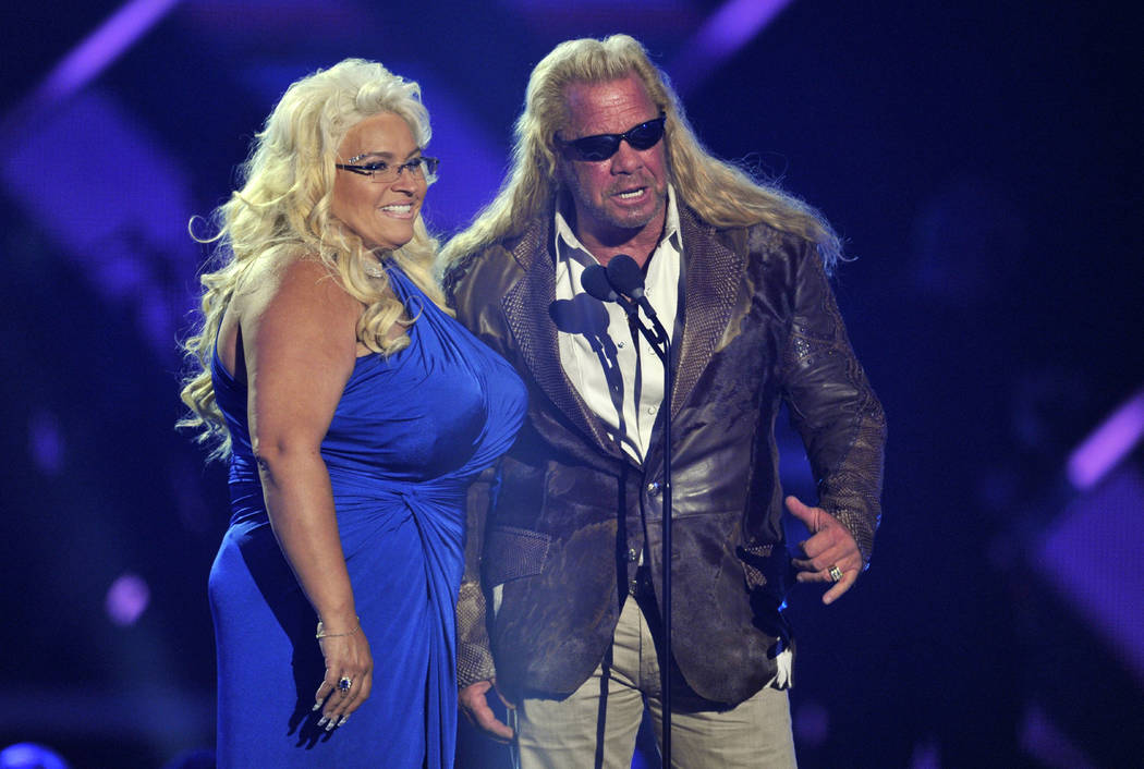 "In this June 5, 2013, file photo, Duane ""Dog"" Chapman, right, and Beth Chapman present the awar ..."