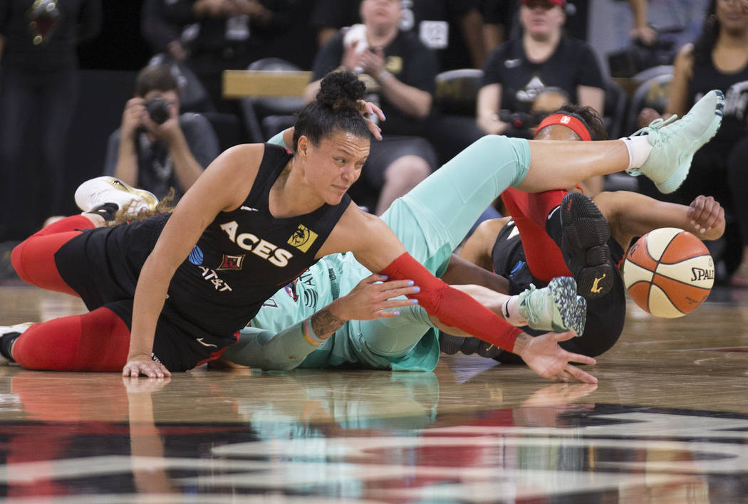 Las Vegas Aces guard Kayla McBride (21) reaches for a loose ball in the first quarter during Ve ...